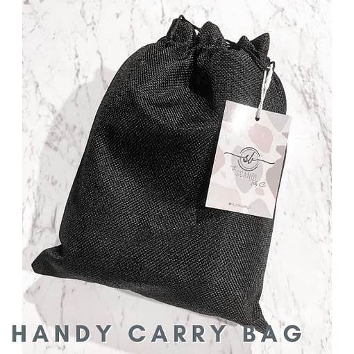 Black Drawstring carry bag for silicone wine glasses. There is a label with The Scandi baby Co logo