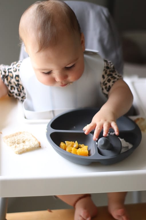 Baby led weaning in highchair, using The Scandi Baby Co Silicone Plate for toddlers